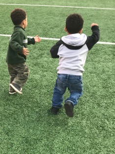 C and D sprinting on the field at Ohio State